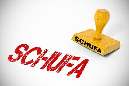 """Gestempeltes Wort """"Schufa"""" und ein Stempel"""